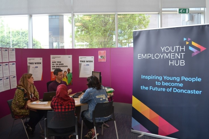 Young adults being helped at the Youth Employment Hub