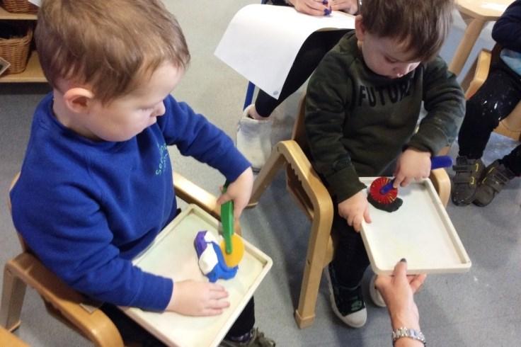 children enjoying play dough
