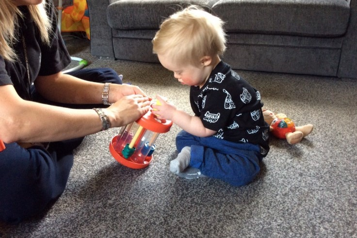 young child playing with toy