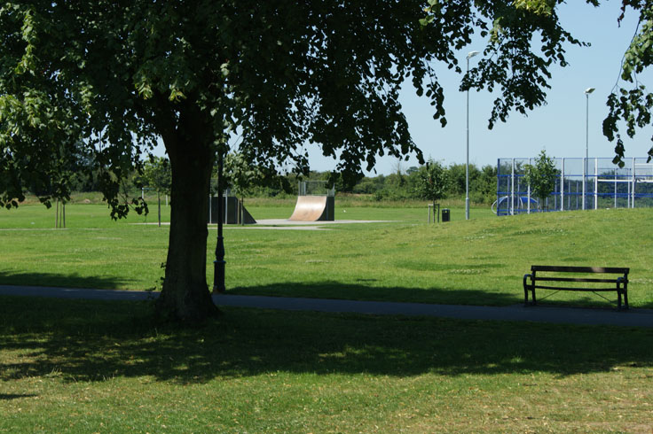 A bike ramp and play area in a park.