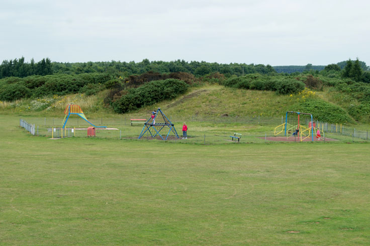 People playing in a park play area.