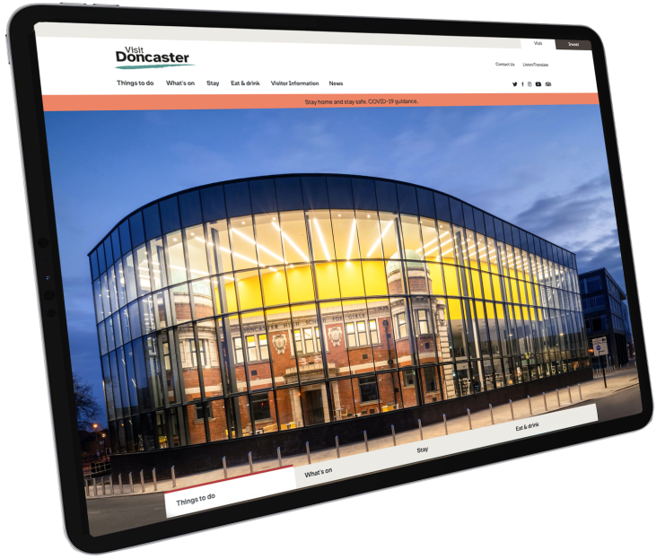 Tablet showcasing the Visit Doncaster website