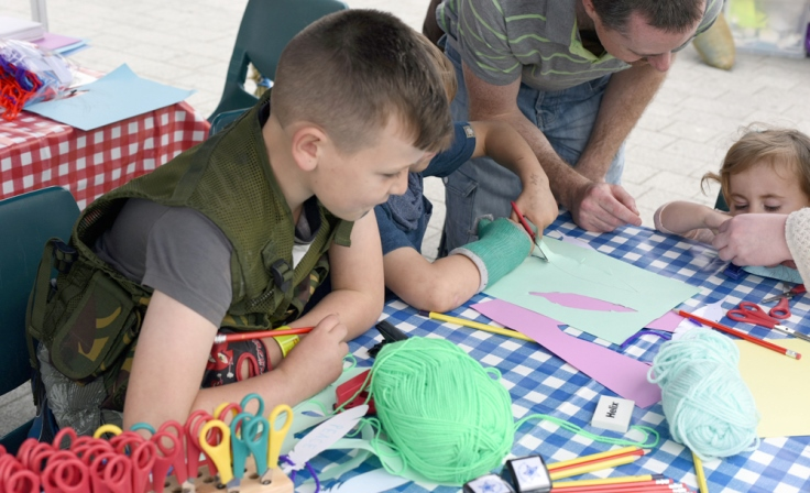 Volunteers assist with our summer holiday family activities