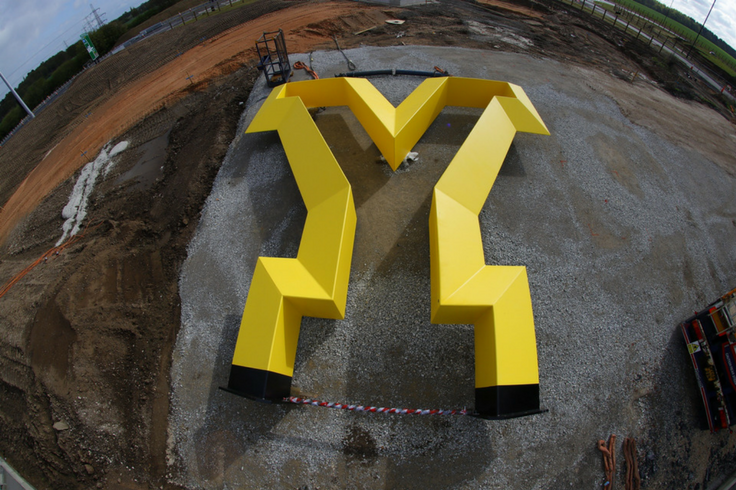A large yellow statue in the shape of a Y.