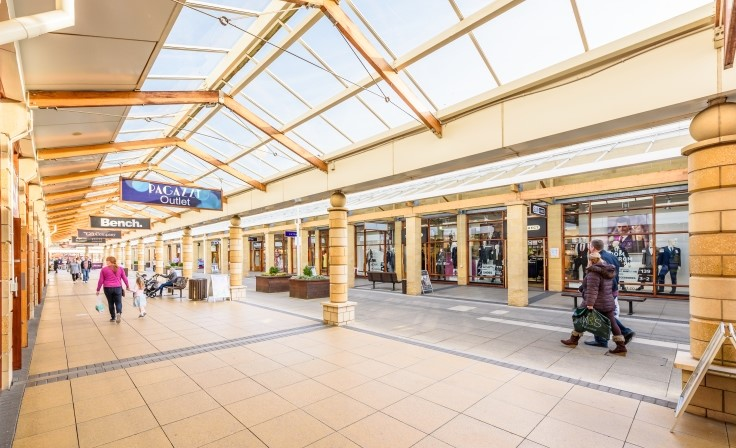 Shops and shoppers at Lakeside Village Shopping Centre