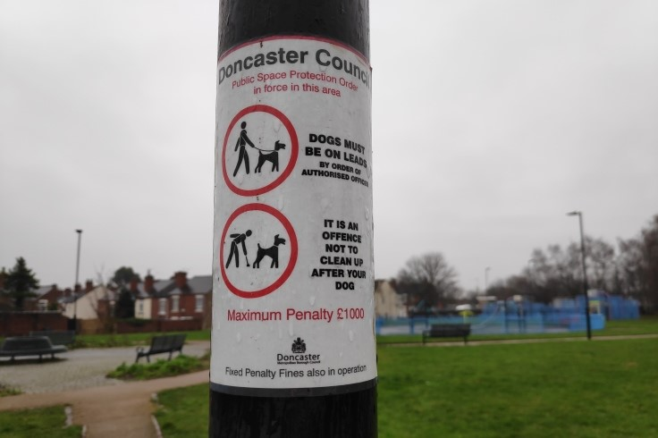 Warning sign for dog owners