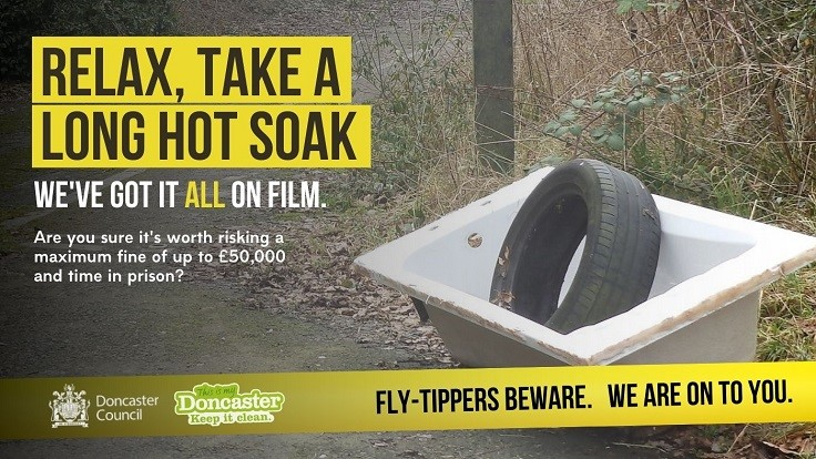 Fly-Tippers Beware Poster showing abandoned bath