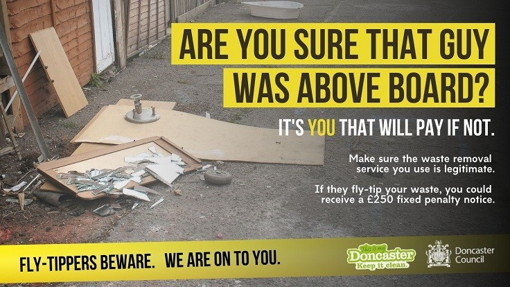 Fly-Tippers Beware Poster showing abandoned timber