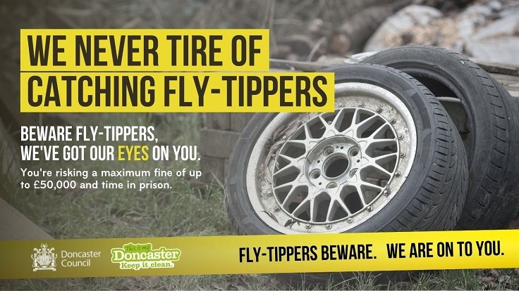 Fly-Tippers Beware Poster showing abandoned tyres