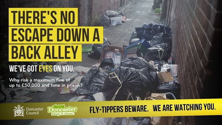 Fly-Tippers Beware Poster showing abandoned household waste in an alley