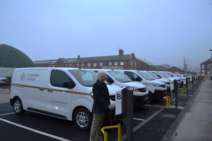 Mayor Ros Jones with the fleet of electric council vans