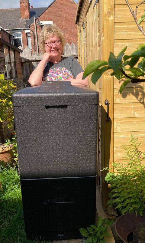 Lynn Evans composting winner stood behind her composting bin