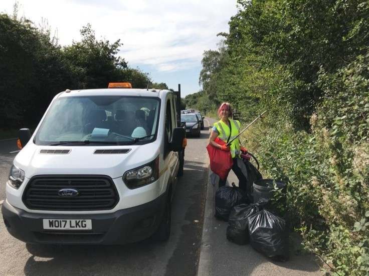 Clearing rubbish at the roadside