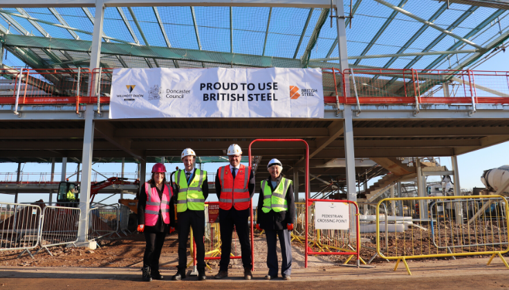 Dignitaries at the site of the new Bader Academy following the completion of its steel structure which is 91% British Steel
