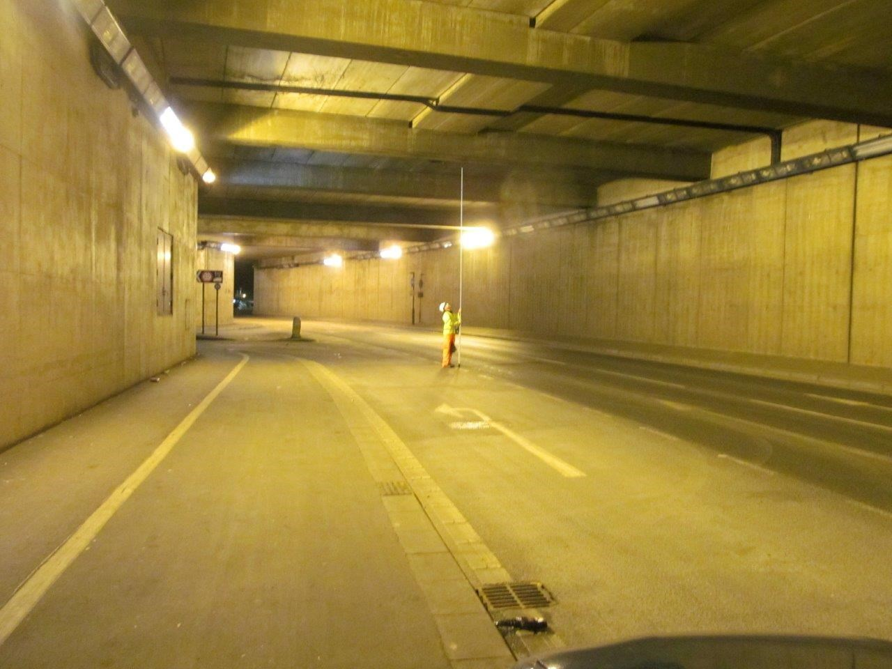 Workers in the tunnel under the Frenchgate Centre at night.