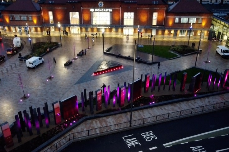 Doncaster railway station forecourt scheme lit up at night